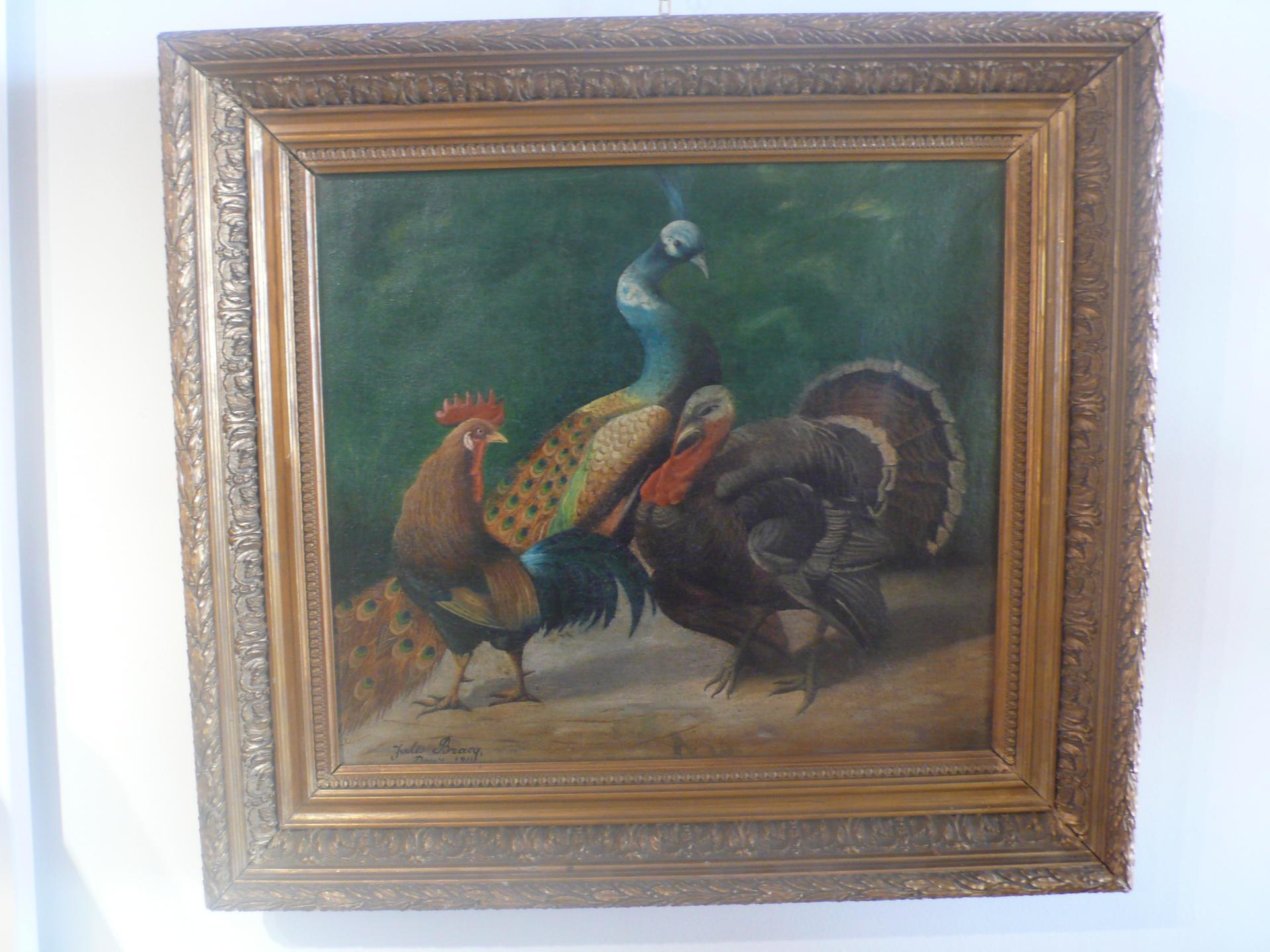 Tableau représentant un paon, un coq et un dindon signé Jules Bracq.